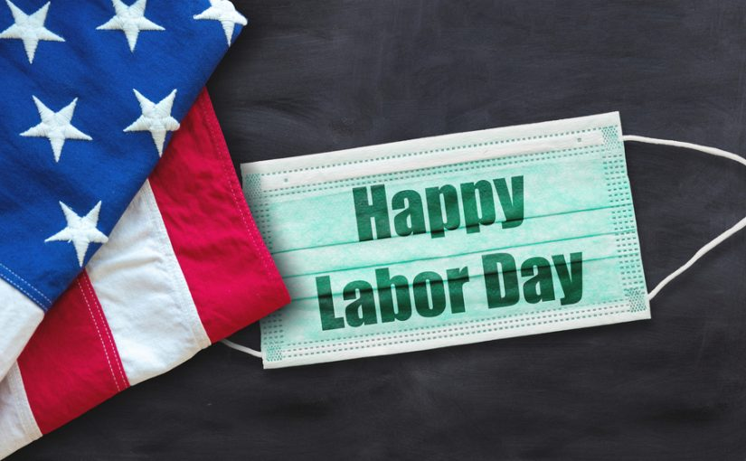 """a surgical mask with """"Happy Labor Day"""" written on it alongside an American flag"""